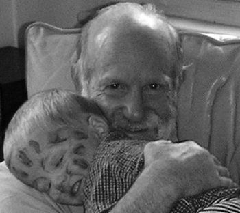 Dr Bob Rich with one of his grandchildren
