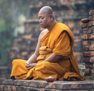 A Buddhist monk meditating